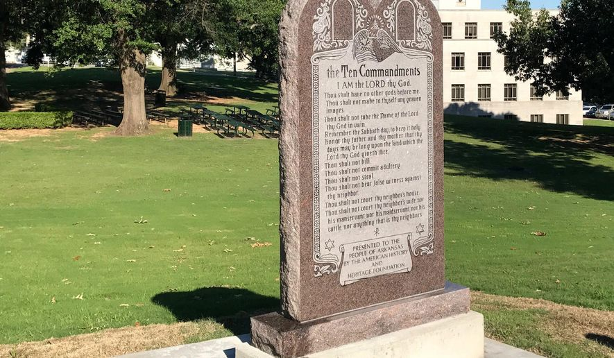 A 6-foot-tall privately funded Ten Commandments monument is seen on the Arkansas Capitol grounds in Little Rock on Tuesday, June 27, 2017, after it was installed by workers two years after lawmakers approved a measure allowing the statue on state property. (AP Photo/Andrew DeMillo)