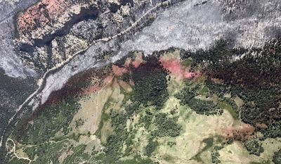 This Monday, June 27, 2017, taken by Justin Harding, shows slurry lines around burnout areas near Parowan, during a tour by Utah Lt. Gov. Spencer Cox, in southern Utah. The nation's largest wildfire has forced more than 1,500 people from their homes and cabins in a southern Utah mountain area home to a ski town and popular fishing lake. (Justin Harding/ State of Utah, Office of the Governor, via AP)