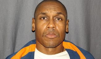This undated photo released by the Michigan Department of Corrections shows Michael Darnell Harris. Harris is serving a life sentence without the possibility of parole in the 1981 killing of Ula Curdy, of Lansing, Mich. Harris effort to reverse his murder and sexual assault convictions from the early 1980s ended Tuesday, June 27, 2017 during a hearing in Ingham County Circuit Court. (Michigan Department of Corrections via AP)