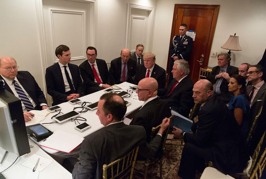 President Donald J. Trump receives a briefing on a military strike on Syria from his National Security team, including a video teleconference with Secretary of Defense, Gen. James Mattis, and Chairman of the Joint Chiefs of Staff, Gen. Joseph F. Dunford, on Thursday April 6, 2017, in a secured location. (Official White House Photo by Shealah Craighead)