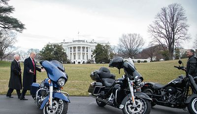 President Donald Trump and Vice President Mike Pence admire several Harley Davidson bikes on the South Lawn driveway of the White House in Washington, D.C. President Trump hosted a lunch for Harley Davidson executives, as well as union representatives for machinist and steel workers, in the Roosevelt Room of the White House in Washington, D.C., Thursday, February 2, 2017. (Official White House Photo by Shealah Craighead)