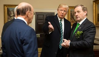 President Donald J. Trump introduces Enda Kenny, the Taoiseach of Ireland, to Wilbur Ross, U.S. Secretary of Commerce, in the West Wing Lobby on Thursday, March 16, 2017, upon the Prime Minister's arrival to the White House. (Official White House Photo by Shealah Craighead) **FILE**