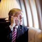President Donald Trump talks on the phone aboard Air Force One during a flight to Philadelphia, Pennsylvania, to address a joint gathering of House and Senate Republicans, in this file photo from Thursday, January 26, 2017.  (Official White House Photo by Shealah Craighead) **FILE**
