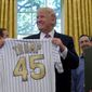 President Trump met with 2016 World Series Champions the Chicago Cubs on Wednesday. The quick change in subject from health care to energy and immigration has left many wondering if Mr. Trump is committed to the 'repeal and replace' bill. (Associated Press)