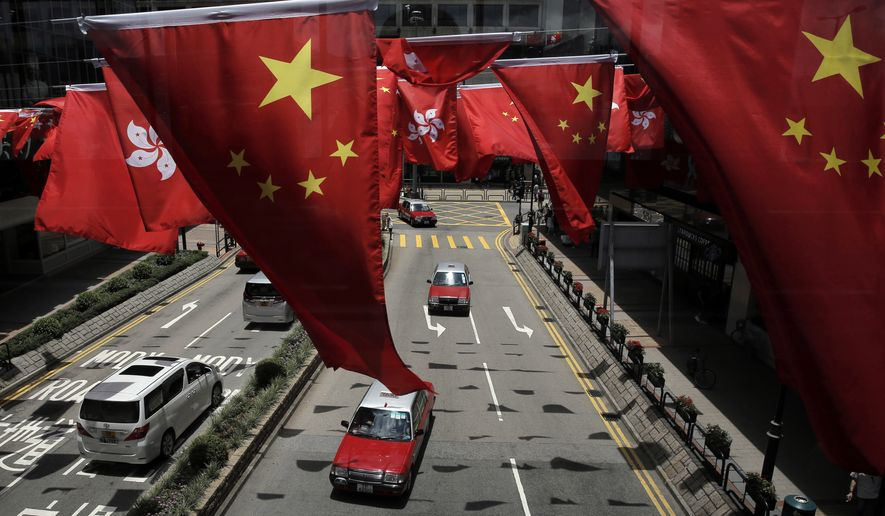 China and Kong Hong national flags are displayed to mark the 20th anniversary of Hong Kong handover to China. Hong Kong is planning a big party as it marks 20 years under Chinese rule, but many people in the former British colony are not in the mood to celebrate. (Associated Press)