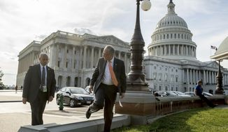 Senate Minority Leader Sen. Chuck Schumer of N.Y., center, arrives to speak to a large group of protesters rally against the Senate Republican healthcare bill on the East Front of the Capitol Building in Washington, Wednesday, June 28, 2017. (AP Photo/Andrew Harnik)
