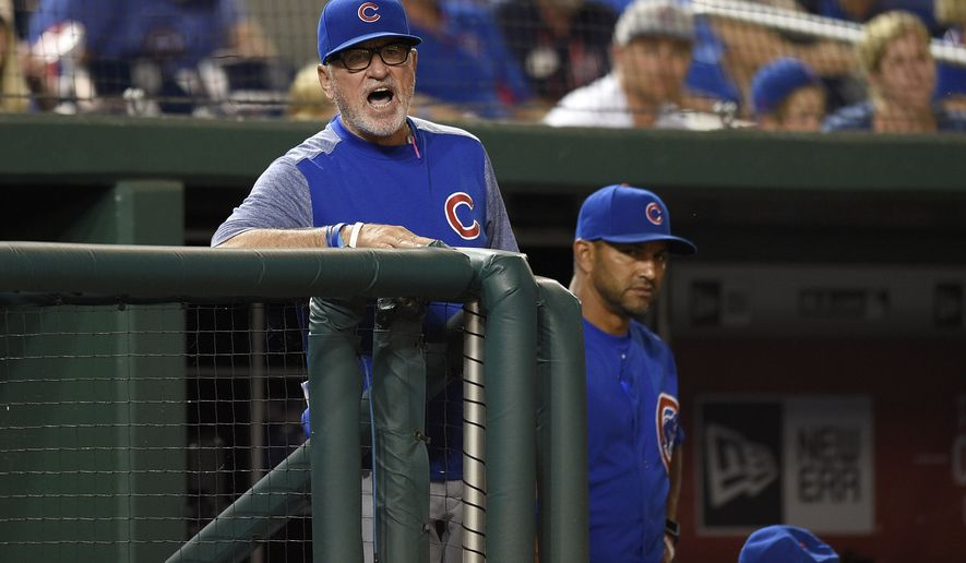 Chicago Cubs manager Joe Maddon reacts during a baseball game against the Washington Nationals, Monday, June 26, 2017, in Washington. The Cubs won 5-4. (AP Photo/Nick Wass)