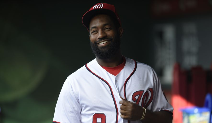 Washington Nationals' Brian Goodwin looks on from the dugout before a baseball game against the Chicago Cubs, Monday, June 26, 2017, in Washington. (AP Photo/Nick Wass)