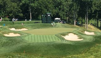 The par-3 ninth hole at TPC Potomac in Potomac, Md. is seen, Wednesday, June 28, 2017. Tiger Woods is the host of the Quicken Loans event, which benefits his foundation. This year, Woods will miss the trophy presentations at both of the PGA Tour events that benefit his foundation. In his absence, Rickie Fowler is the top draw at the Quicken Loans National. The field includes just three of the top 20 players in the world. (AP Photo/Ben Nuckols)