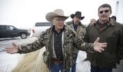 "FILE - In this Jan. 9, 2016 file photo, Robert ""LaVoy"" Finicum, left, a rancher from Arizona, talks to reporters at the Malheur National Wildlife Refuge near Burns, Ore. FBI Special Agent W. Joseph Astarita has been indicted in Portland Ore., Wednesday, June 28, 2017, on accusations that he lied about firing at Finicum when officers arrested leaders of an armed occupation of a federal wildlife refuge in rural Oregon.(AP Photo/Rick Bowmer, File)"