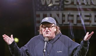 "In this Thursday, Jan. 19, 2017, filmmaker Michael Moore speaks to thousands of people at an anti-Trump rally and protest in front of the Trump International Hotel in New York. Moore, who is making his Broadway debut this summer in a solo show, says he will donate $10,000 to New York City's Shakespeare in the Park after it lost funding from sponsors due to its controversial ""Julius Caesar"" production. (AP Photo/Kathy Willens, File) **FILE**"