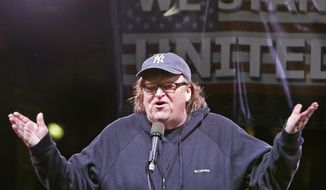 Filmmaker Michael Moore speaks to thousands of people at an anti-Trump rally and protest in front of the Trump International Hotel in New York, Jan. 19, 2017. (AP Photo/Kathy Willens) **FILE**