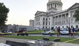 The new Ten Commandments monument outside the state Capitol in Little Rock, Ark., is blocked off Wednesday morning, June 28, 2017, after someone crashed into it with a vehicle, less than 24 hours after the privately funded monument was placed on the Capitol grounds. Authorities arrested a male suspect. (AP Photo/Jill Zeman Bleed)