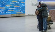 FILE - In this Feb. 5, 2017, file photo, Abdullah Alghazali, right, hugs his 13-year-old son Ali Abdullah Alghazali after the Yemeni boy stepped out of an arrival entrance at John F. Kennedy International Airport in New York. U.S. Customs and Border Protection officers will be key players in putting President Donald Trump's revised travel ban into effect on Thursday, June 29, affecting visitors from six mostly Muslim countries: Iran, Libya, Somalia, Sudan, Syria, and Yemen. (AP Photo/Alexander F. Yuan, File)