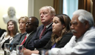 "President Donald Trump meets with what the White House identifies as ""immigration crime victims"" to urge passage of House legislation to save American lives, Wednesday, June 28, 2017, in the Cabinet Room at the White House in Washington. (AP Photo/Manuel Balce Ceneta)"
