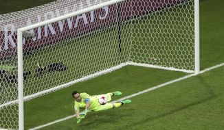 Chile goalkeeper Claudio Bravo make a save in the shoot-out of the Confederations Cup, semifinal soccer match between Portugal and Chile, at the Kazan Arena, Russia, Wednesday, June 28, 2017. (AP Photo/Dmitri Lovetsky)