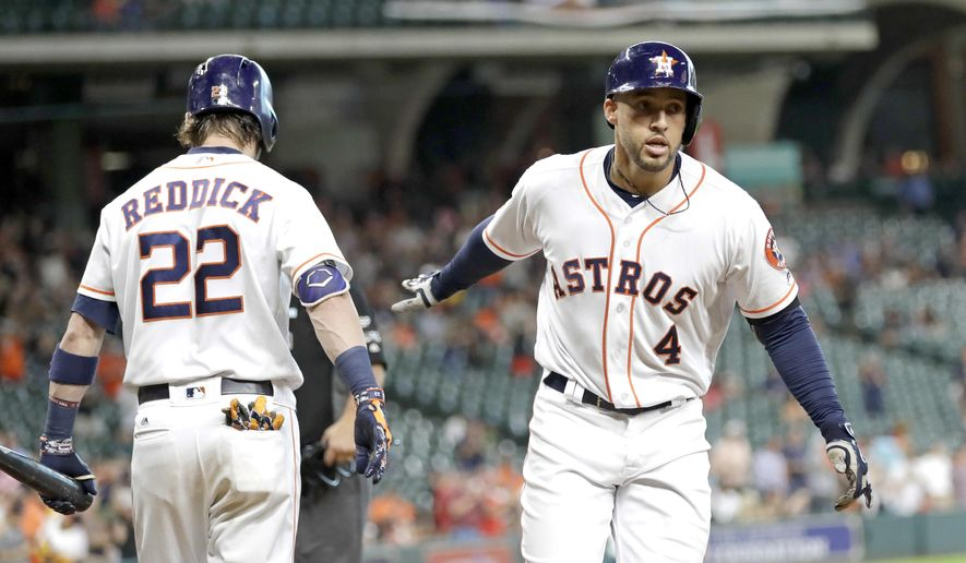Houston Astros' George Springer (4) celebrates with Josh Reddick (22) after hitting a home run during the first inning of a baseball game against the Oakland Athletics, Wednesday, June 28, 2017, in Houston. (AP Photo/David J. Phillip)