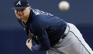 Atlanta Braves starting pitcher Sean Newcomb watches a throw during the first inning of the team's baseball game against the San Diego Padres in San Diego, Tuesday, June 27, 2017. (AP Photo/Alex Gallardo)