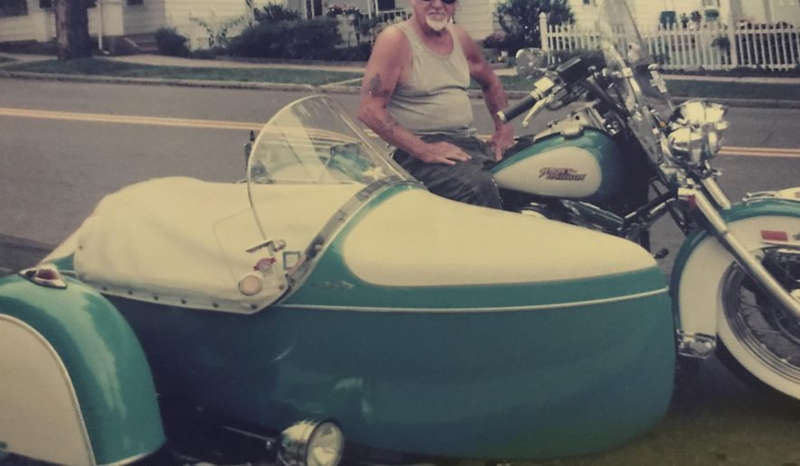 In this 2010 photo provided by the family of Arthur Werner Sr., Werner poses for a photo on his 1990 Harley-Davidson Heritage Softail motorcycle in Bethlehem, Pa. Werner, of Steel City, Pa., died of cancer Sunday, June 25, 2017, but made plans to be buried in his motorcycle's sidecar after his funeral scheduled Friday, June 30, 2017. (Brittany Werner via AP)
