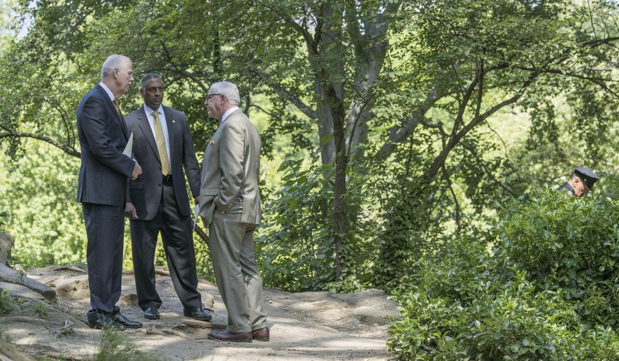 NYPD Detectives Chief Robert Boyce, left, Deputy Commissioner of Intelligence & Counter-terrorism John Miller, right, and ATF New York Field Division Special Agent in Charge Ashan Benedict speak near the scene of an unsolved 2016 explosion in New York's Central Park, Wednesday, June 28, 2017. (AP Photo/Mary Altaffer)