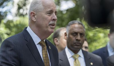 NYPD Detectives Chief Robert Boyce, left, and ATF New York Field Division Special Agent in Charge Ashan Benedict speak to reporters during a news conference near the scene of an unsolved 2016 explosion in New York's Central Park, Wednesday, June 28, 2017. The New York Police Department and federal officials are offering up to $40,000 in reward money for information that leads to an arrest in the explosion last summer in Central Park that injured a tourist.  (AP Photo/Mary Altaffer)
