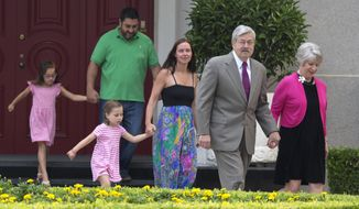 "U.S. Ambassador to China Terry Branstad, second from right, walks with his wife Christine Branstad at right and other members of his family during a photocall and remarks to journalists at the Ambassador's residence in Beijing, China, Wednesday, June 28, 2017. A self-described ""farm boy from Iowa"" who's known China's president for more than 30 years, Terry made his first public appearance as the new U.S. ambassador in Beijing on Wednesday, assuming the post at a time when President Donald Trump has injected a strong dose of unpredictability into America foreign diplomacy.  (AP Photo/Ng Han Guan)"