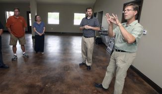 In this Monday, June 19, 2017 photo, board members of the new Christian Academy for the Deaf, look on as chairman Lewis Lummer, right, uses sign language to discuss the potential site of the new school, in Waco, Texas. Lummer comes from four generations of deafness, and he's leading an effort to offer a Christian school experience for deaf children. (Jerry Larson/Waco Tribune-Herald via AP)