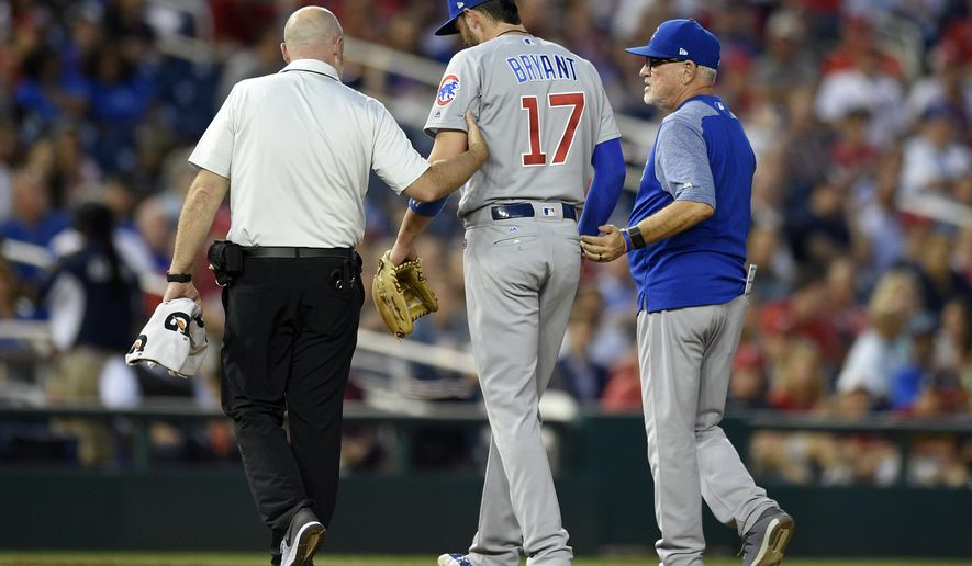Chicago Cubs third baseman Kris Bryant (17) is helped off the field by a trainer and Chicago Cubs manager Joe Maddon, right, after he was injured during the fifth inning of the team's baseball game against the Washington Nationals, Wednesday, June 28, 2017, in Washington. (AP Photo/Nick Wass)