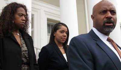 State Attorney Aramis Ayala, center, listens as her lawyer Roy Austin, right, talks to reporter after Austin asked the Florida Supreme Court to return 24 murders cases Gov. Rick Scott reassigned to another prosecutor because Ayala won't seek the death penalty. The court heard arguments Wednesday, June 28, 2017, in Tallahassee, Fla. (AP Photo/Brendan Farrington)