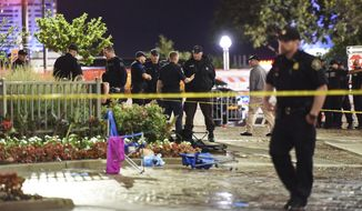 Police investigate after a woman was shot at the annual fireworks event in downtown Detroit on Monday, June 26, 2017. One adult and one juvenile were taken into custody, and authorities said a weapon was recovered. (Tanya Moutzalias/The Ann Arbor News via AP)