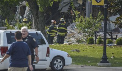 Emergency personnel respond to new Richmond Hall on the Murray State University campus after an explosion occurred, Wednesday, June 28, 2017. Officials say a blast at an unused Kentucky dormitory has caused extensive damage, with one employee hospitalized with injuries. Calloway County Emergency Management Director Bill Call told media outlets that the explosion at Murray State University was believed to have been caused by a natural gas leak.  (Edward Marlowe/The Paducah Sun via AP)