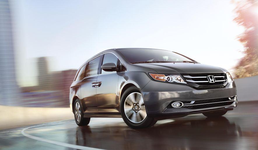 This photo provided by Honda North America shows the 2017 Honda Odyssey. The Odyssey offers great functionality and space. The second-row seats move forward for easy access, and the middle second-row seat even slides forward so front passengers can tend to little ones in a car seat. Its third row can comfortably seat two adults and still leave plenty of room in back for luggage and kid stuff. (Honda North America via AP)