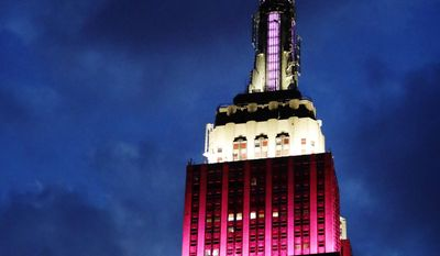 In this Tuesday, June 27, 2017, photograph, the Empire State Building in New York City is lit up in burgundy and white for Qatar Airways in New York. The top of the Empire State Building was lit in the airlines' colors Tuesday night to recognize its 10th anniversary of flying to the United States. (AP Photo/Frank Franklin II)