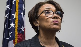 FILE - In this June 20, 2017, file photo, Flint, Mich. Mayor Karen Weaver listens to a question during a closed news conference discussing the water source recommendation made for Flint at City Hall. The state of Michigan sued Flint on Wednesday, June 28, 2017, alleging that the city council's refusal to approve a broadly backed deal to buy water long term from a Detroit-area system is endangering public health in the wake of a man-made crisis that left the supply contaminated with lead. The Department of Environmental Quality had threatened legal action if the council did not approve Weaver's recommendation or propose a reasonable alternative by Monday.(Shannon Millard/The Flint Journal-MLive.com via AP, File)