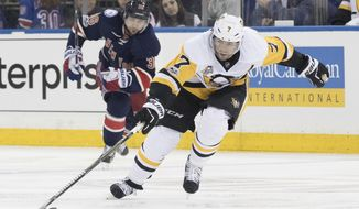 FILE - In this March 31, 2017, file photo, Pittsburgh Penguins center Matt Cullen (7) controls the puck as he skates past New York Rangers right wing Mats Zuccarello during an NHL hockey game in New York. Cullen, at 40, could be among the players available when free agency begins Saturday. (AP Photo/Mary Altaffer, File)