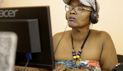 ADVANCE FOR MONDAY, JULY 3, 2017 - In this Tuesday, June 20, 2017 photo, Geneice Baymon takes an online test as part of a job application for United Healthcare at Operation Jobs, a service offered by Cypress Assistance Ministries, in Houston. (Melissa Phillip/Houston Chronicle via AP)