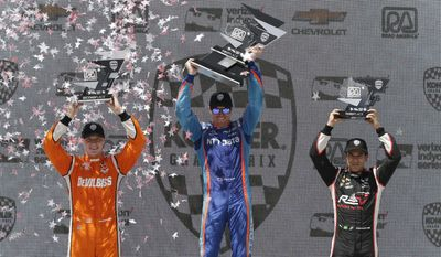 Top three finishers in the Kohler Grand Prix celebrate at the podium, from left, Josef Newgarden, second, Scott Dixon, first, and Helio Castroneves, third, Sunday, June 25, 2017, at Elkhart Lake's Road America in Elkhart Lake, Wis. (Gary C. Klein/The Post-Crescent via AP)