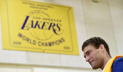 Brook Lopez, a new member of the Los Angeles Lakers, waits to be interviewed following an introductory news conference with the NBA basketball team Wednesday, June 28, 2017, in El Segundo, Calif. (AP Photo/Chris Pizzello)