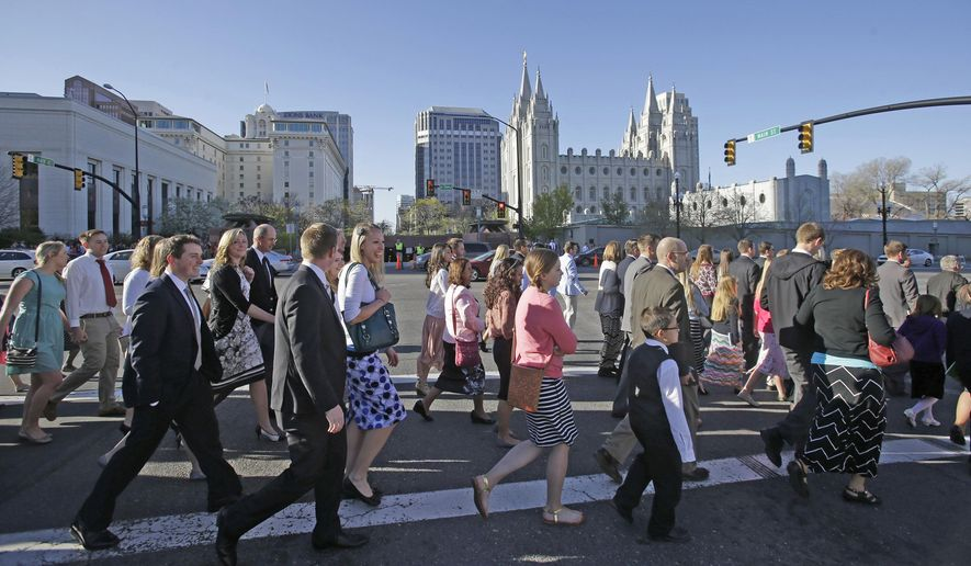 FILE - In this April 4, 2015, file photo, Mormon women wear dresses on their way to the religion's twice-yearly conference in Salt Lake City. Church leaders announced Wednesday, June 28, 2017, that women who work at church headquarters in Salt Lake City can now wear pantsuits or dress slacks instead of only skirts or dresses. Men who work for the church will also now be allowed to remove their suit coats in hot weather. (AP Photo/Rick Bowmer, File)
