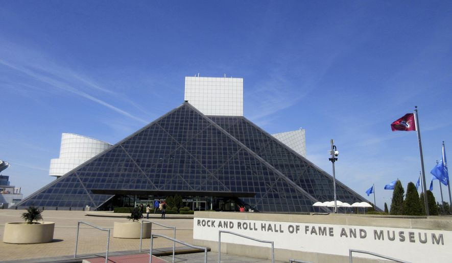 This April 24, 2016, file photo shows the Rock and Roll Hall of Fame and Museum, located on the shores of Lake Erie in downtown Cleveland. (AP Photo/Beth J. Harpaz, File)