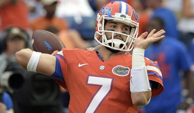 FILE - In this Oct. 3, 2015, file photo, Florida quarterback Will Grier warms up before an NCAA college football game against Mississippi in Gainesville, Fla. Grier was suspended for failing a test for performance-enhancing substances. After sitting out last season, Grier is eligible for the start of 2017. Mountaineers fans are excited, but it should be noted that Grier's resume includes four SEC games: one sensational performance against Ole Miss and three OK outings against Kentucky, Tennessee and Missouri. (AP Photo/Phelan M. Ebenhack, file)