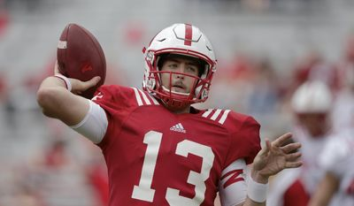 FILE - This April 15, 2017 file photo shows Nebraska quarterback Tanner Lee (13) warming up before the annual NCAA college football Red-White spring game, in Lincoln, Neb. The Tulane transfer won the job in the spring practice after sitting out last season. Lee was a starter for two seasons for the Green Wave and his numbers were not good. He threw 23 touchdown passes and 21 interceptions and completed 53.5 percent of his passes. (AP Photo/Nati Harnik)
