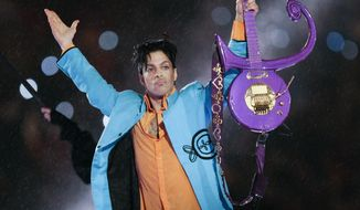 FILE - In this Feb. 4, 2007 file photo, Prince performs during the halftime show of the Super Bowl XLI football game at Dolphin Stadium in Miami. Lawyers for Universal Music Group have renewed their request that a Minnesota judge cancel the company's music rights deal with Prince's estate, saying UMG will otherwise have to sue according to a court filing made public Tuesday, June 27, 2017. (AP Photo/Chris O'Meara, File)