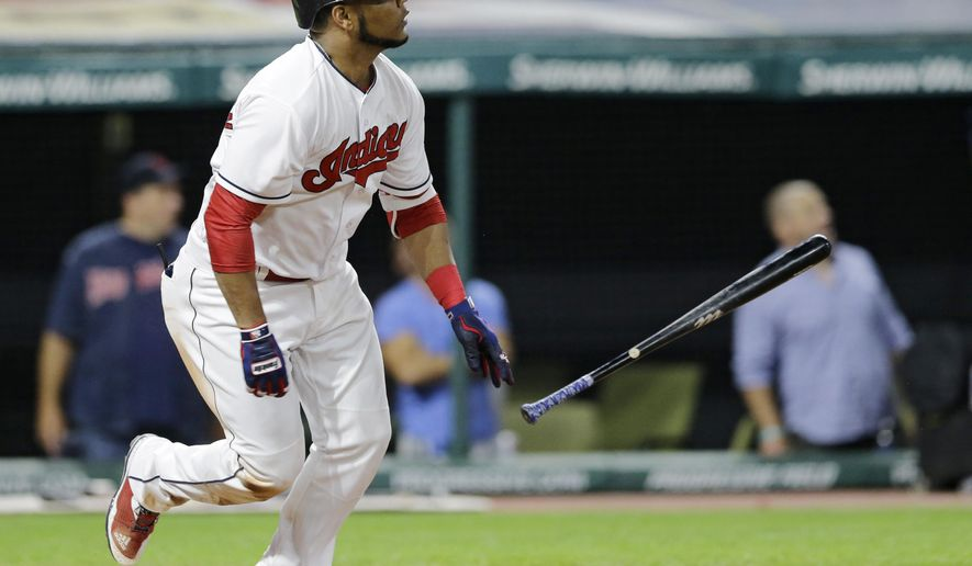 Cleveland Indians' Edwin Encarnacion watches his ball after hitting an RBI-single off Texas Rangers relief pitcher Dario Alvarez in the seventh inning of a baseball game, Wednesday, June 28, 2017, in Cleveland. Roberto Perez scored on the play. (AP Photo/Tony Dejak)
