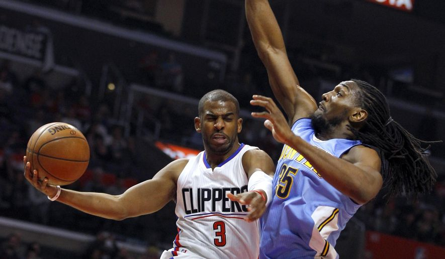 FILE - In this Feb. 24, 2016, file photo, Los Angeles Clippers guard Chris Paul (3) goes up under the basket, next to Denver Nuggets forward Kenneth Faried (35) during the first half of an NBA basketball game in Los Angeles. The Houston Rockets have reached an agreement to trade for Los Angeles Clippers point guard Chris Paul according to a person familiar with the deal. The league source spoke to The Associated Press on Wednesday, June 28, 2017, on the condition of anonymity because the team hasn't finalized the trade. (AP Photo/Alex Gallardo, File)