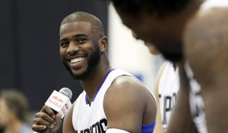 FILE - In this Sept. 26, 2016, file photo, Los Angeles Clippers' Chris Paul laughs as he, Blake Griffin and DeAndre Jordan, right, talk during the team's NBA basketball media day, in Playa Vista, Calif. The Houston Rockets have reached an agreement to trade for Los Angeles Clippers point guard Chris Paul according to a person familiar with the deal. The league source spoke to The Associated Press on Wednesday, June 28, 2017,  on the condition of anonymity because the team hasn't finalized the trade.(AP Photo/Ryan Kang, File)