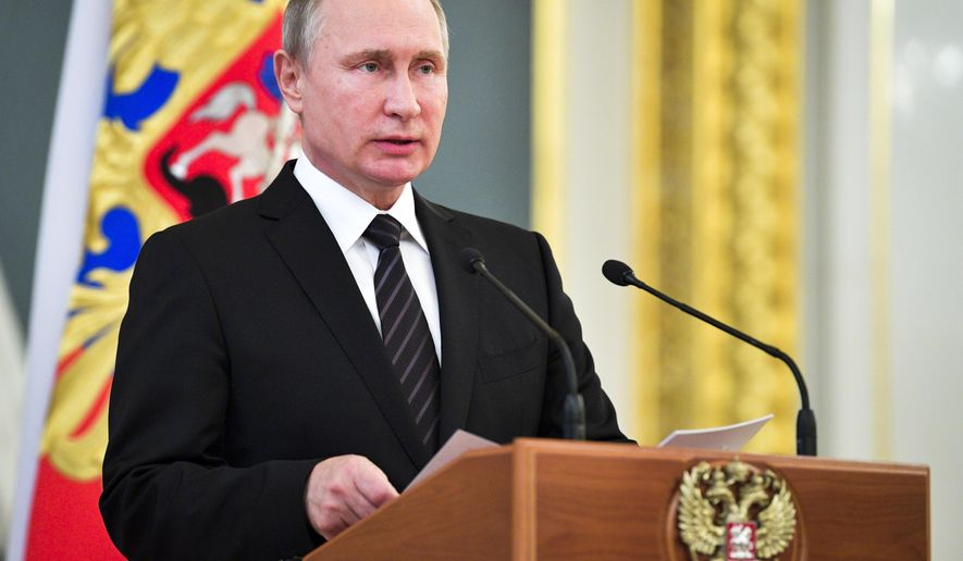 Russian President Vladimir Putin addresses graduates of military and police academies in Moscow,s Kremlin, Russia, Wednesday, June 28, 2017. Putin has pledged to continue efforts to beef up the Russian military and law-enforcement agencies. (Alexei Druzhinin/Sputnik, Kremlin Pool Photo via AP)
