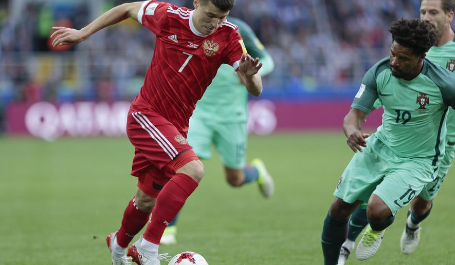 FILE -  In this Wednesday, June 21, 2017 file photo Russia's Dmitry Poloz runs with the ball during the Confederations Cup, Group A soccer match between Russia and Portugal, at the Spartak Stadium in Moscow,. Zenit St. Petersburg has signed forward Dmitry Poloz as it seeks to rebuild its squad under new coach Roberto Mancini.(AP Photo/Ivan Sekretarev, File)