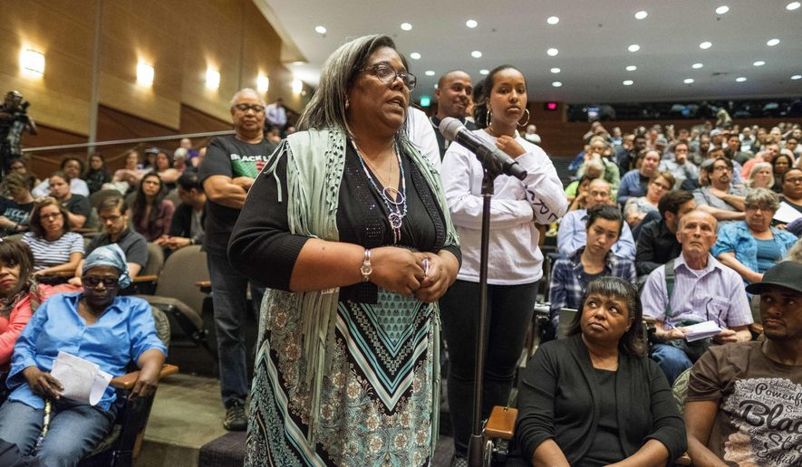Women speak at a public hearing on the fatal shooting of Charleena Lyles Tuesday, June 27, 2017, in Seattle. Seattle City Councilmember M. Lorena Gonzalez, Chair of the Council's Safe Communities Committee (GESCNA) hosted a town hall forum in response to community calls for a public hearing around the recent death of Lyles.  Officers Steven McNew and Jason Anderson shot and killed Lyles June 18 in front of three of her children after she called police to report a burglary and then allegedly confronted officers with kitchen knives. (Dean Rutz/The Seattle Times via AP)