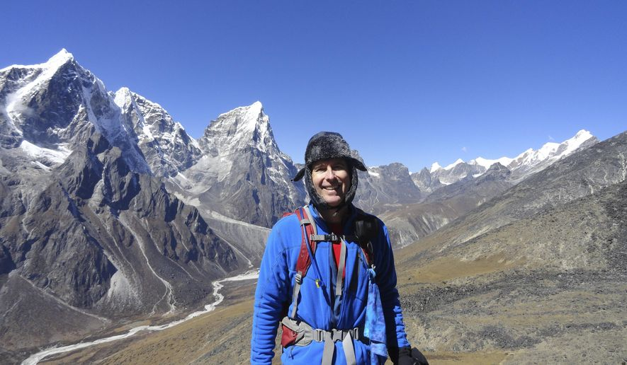 In this Oct. 12, 2012, photo, provided by Mike Scanlin, small business owner Scanlin poses for a photo on the trail to Mount Everest Base Camp in Nepal. Changes in technology have made it possible for vacationing small business owners to never be out of touch, unless they decide to go to a part of the world without enough cellphone towers, bandwidth or electricity. (Courtesy of Mike Scanlin via AP)